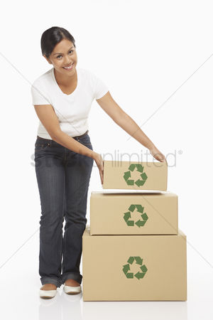 Bidayuh ethnicity : Woman placing a cardboard box on top of a stack of cardboard boxes