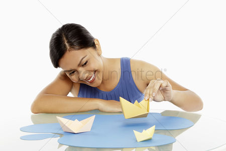 Bidayuh ethnicity : Woman playing with paper boats