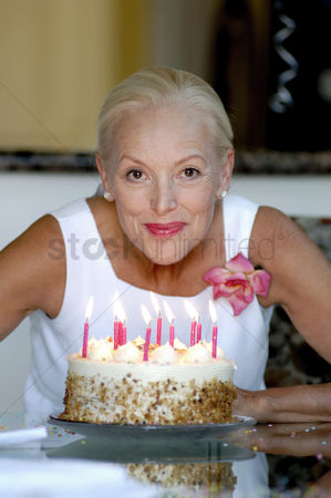 Aging process : Woman posing with her birthday cake