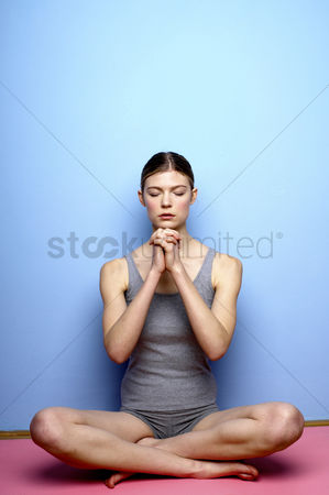 Shape : Woman practicing yoga