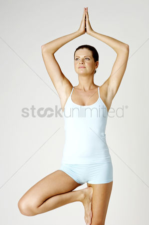 Three quarter length : Woman practicing yoga