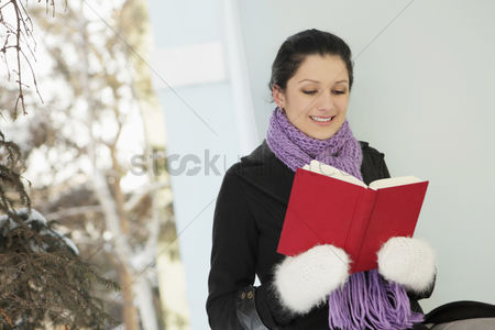 Cold temperature : Woman reading book at the porch