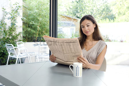 Refreshment : Woman reading newspaper