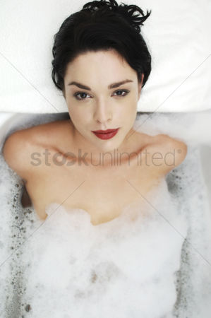Relaxing : Woman relaxing in the bathtub