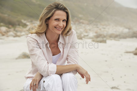 Posed : Woman relaxing on beach