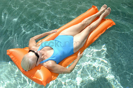 Relaxing : Woman relaxing on pool raft