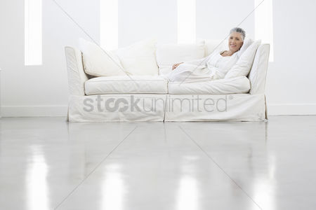 Gaze : Woman relaxing on white sofa