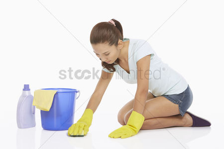 China : Woman scrubbing the floor with a sponge