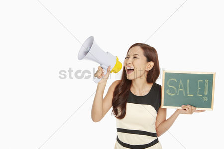 China : Woman shouting into a megaphone while holding up sale