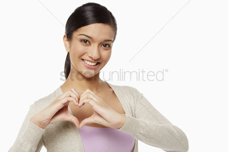 Heart : Woman showing hand gesture