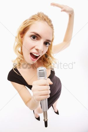 Dancing : Woman singing into microphone