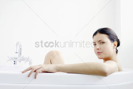 Satisfying : Woman sitting in the bathtub