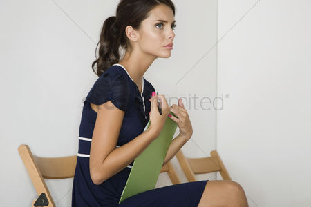 Ponytail : Woman sitting side view
