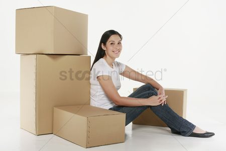 Interior background : Woman sitting with carboard boxes