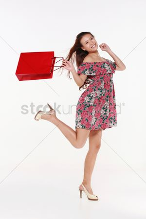 Shopping background : Woman skipping happily after shopping
