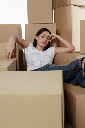 Interior background : Woman sleeping with cardboard boxes around her