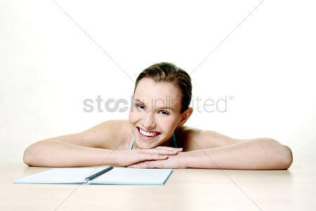 Workbook : Woman smiling at the camera
