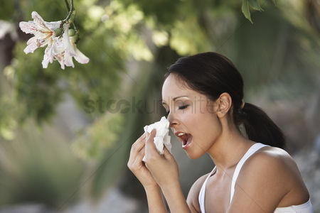 Count : Woman sneezing under tree