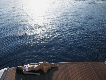 Blank : Woman sunbathing on yacht