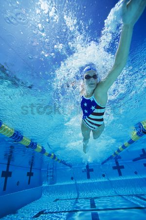 Swimmer : Woman swimming underwater  low angle view