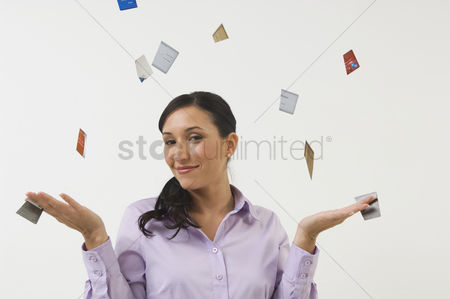 Posed : Woman throwing away credit cards