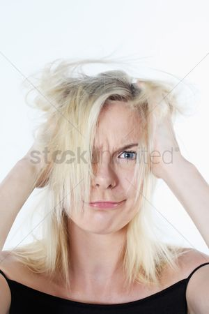 British ethnicity : Woman tousling her hair