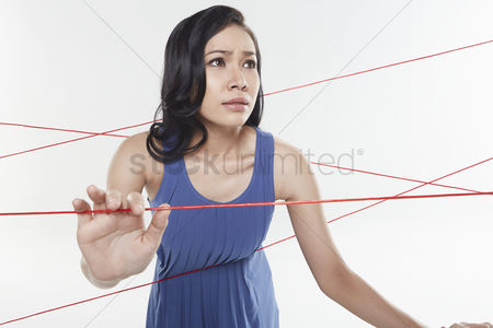 Femininity : Woman trapped in between tangled wires