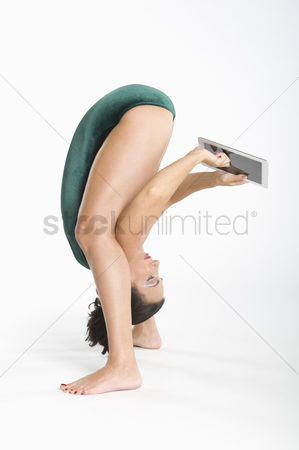 Technology background : Woman  using digital tablet while exercising