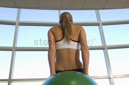 Body : Woman using exercise ball in gym