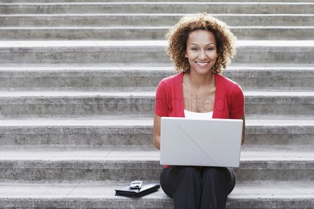 Steps : Woman using laptop on steps portrait
