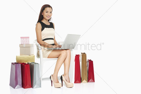 Portability : Woman using laptop while sitting