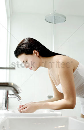 Refreshment : Woman washing hands in the bathroom