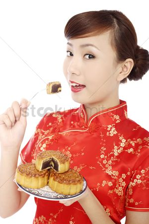 Traditional clothing : Woman wearing cheongsam eating mooncake
