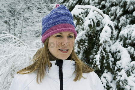 Coldness : Woman wearing knit hat and winter clothing standing outdoor