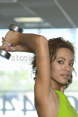 Dumbbell : Woman weightlifting with dumbbell