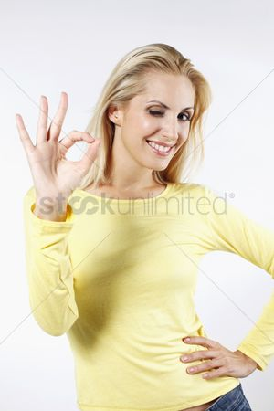Respect : Woman winking while showing ok sign