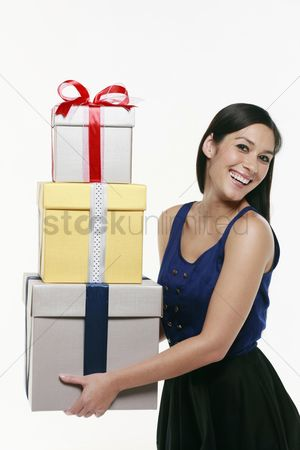 Birthday present : Woman with a stack of gift boxes