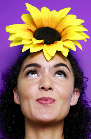Cheerful : Woman with a sunflower on top of her head