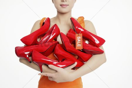 Shopping background : Woman with an armful of shoes