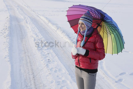 Cold temperature : Woman with an umbrella
