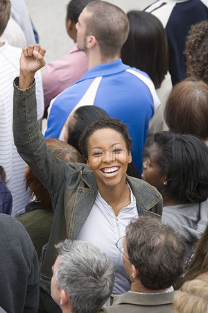 Demonstration : Woman with arm raised in crowd