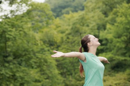 Sports : Woman with arms outstretched and eyes closed