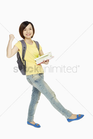China : Woman with backpack and book showing hand gesture