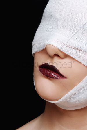 British ethnicity : Woman with bandaged face