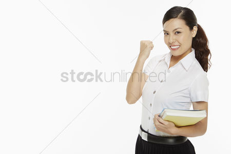 Three quarter length : Woman with books cheering
