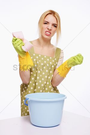 Housewife : Woman with cleaning sponge looking frustrated