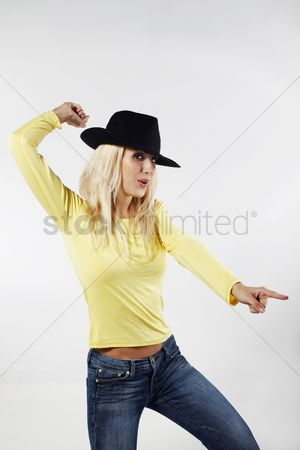 Eastern european ethnicity : Woman with cowboy hat dancing