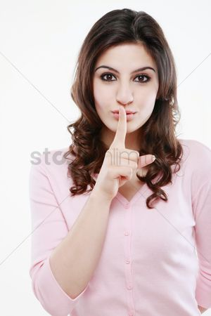 Finger : Woman with finger on lips