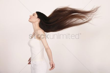 Three quarter length : Woman with hair blowing in the wind