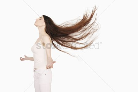 Eastern european ethnicity : Woman with hair blowing in the wind